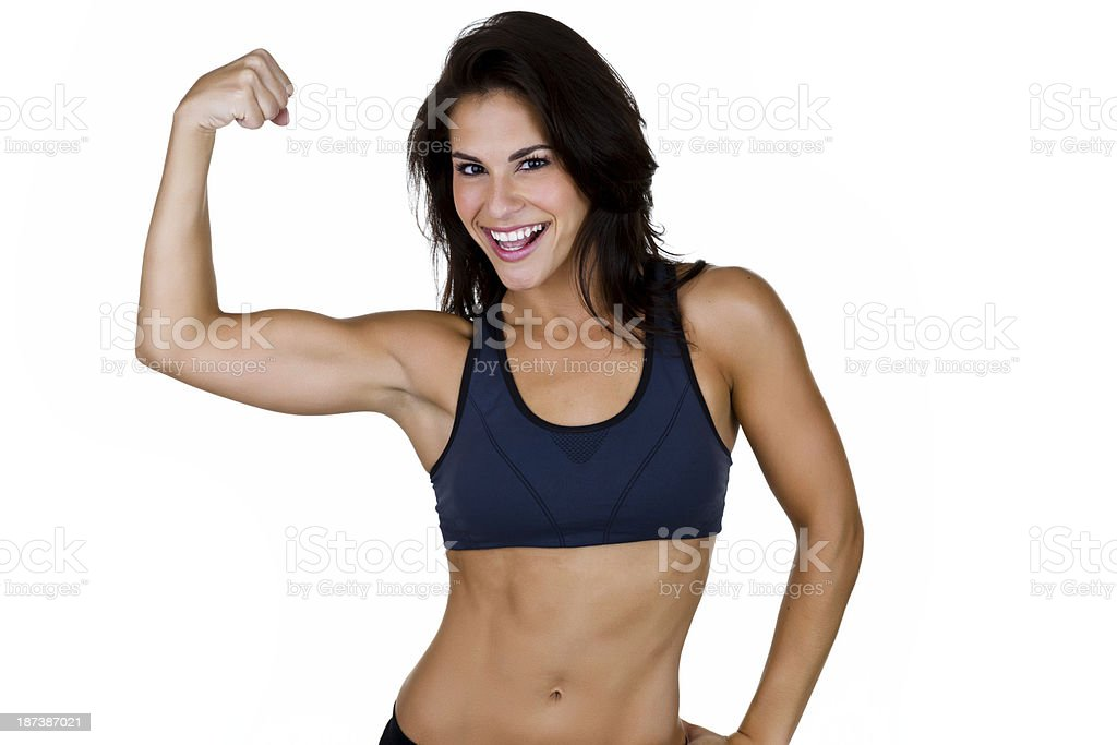 Pretty woman flexing her muscles royalty-free stock photo