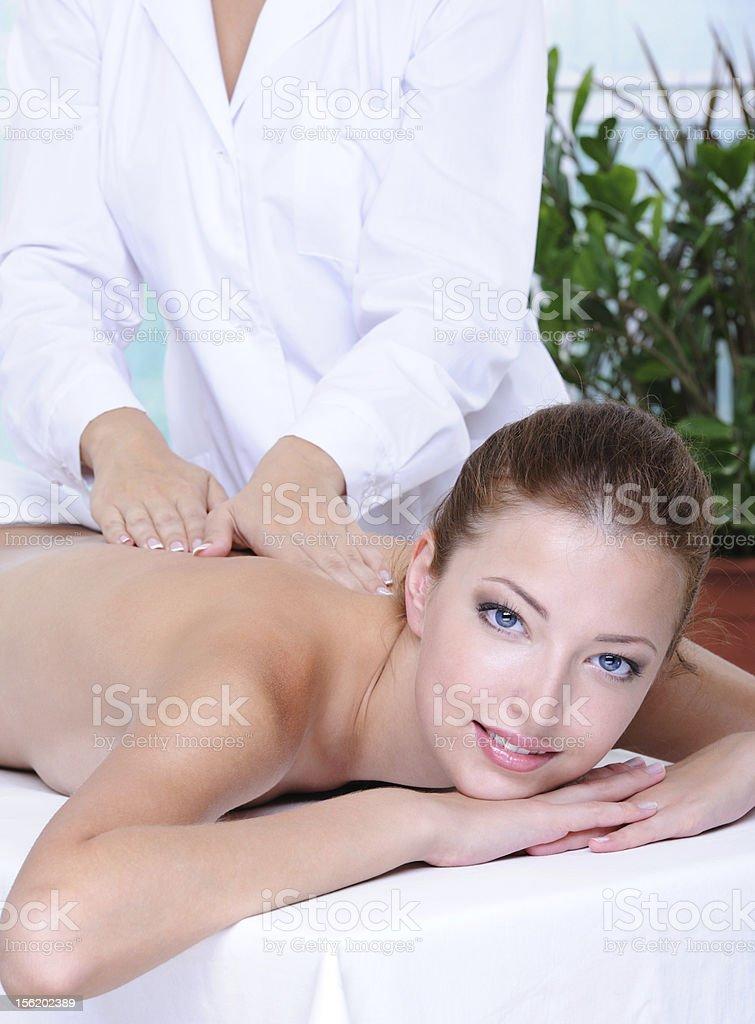 Pretty woman getting back massage royalty-free stock photo