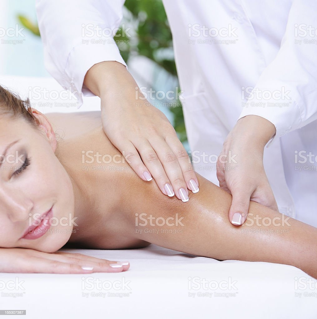 Pretty woman getting massage of shoulder stock photo