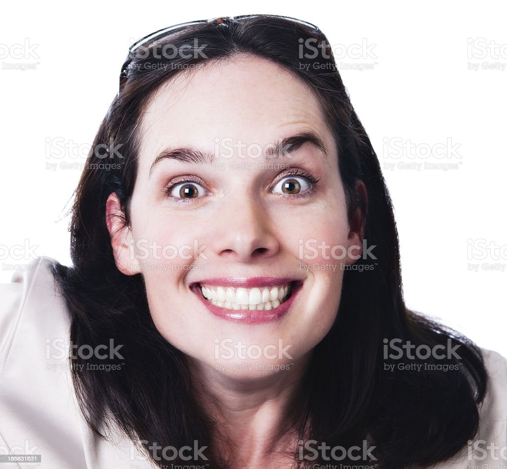 Pretty woman grins in glee stock photo