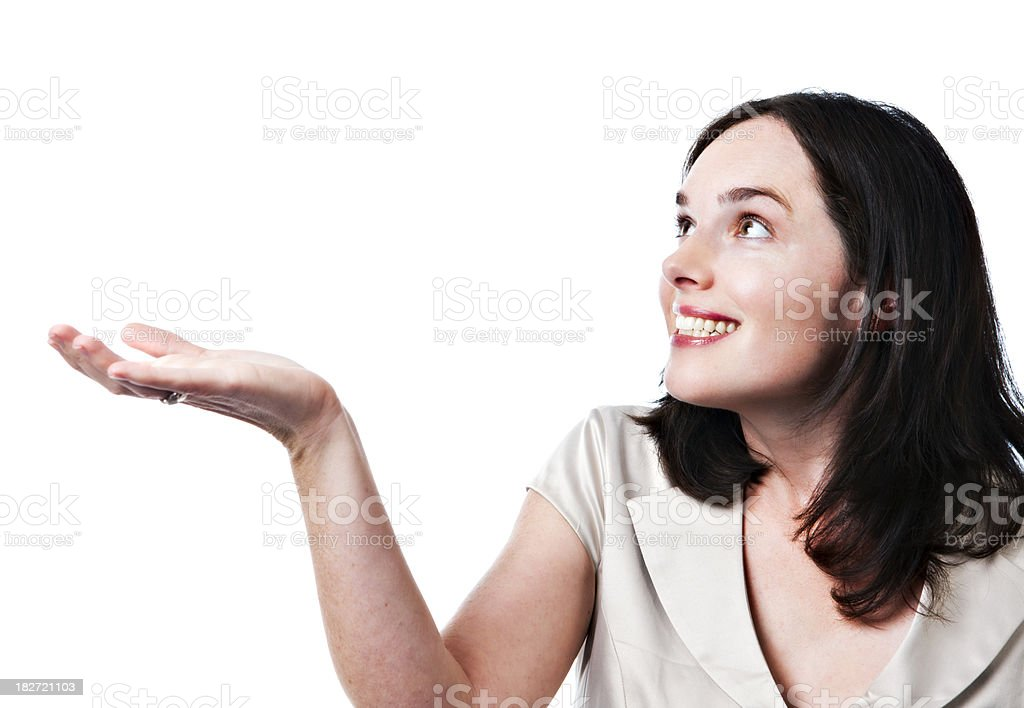 Pretty woman holds hand up, smiling, waiting for what? stock photo