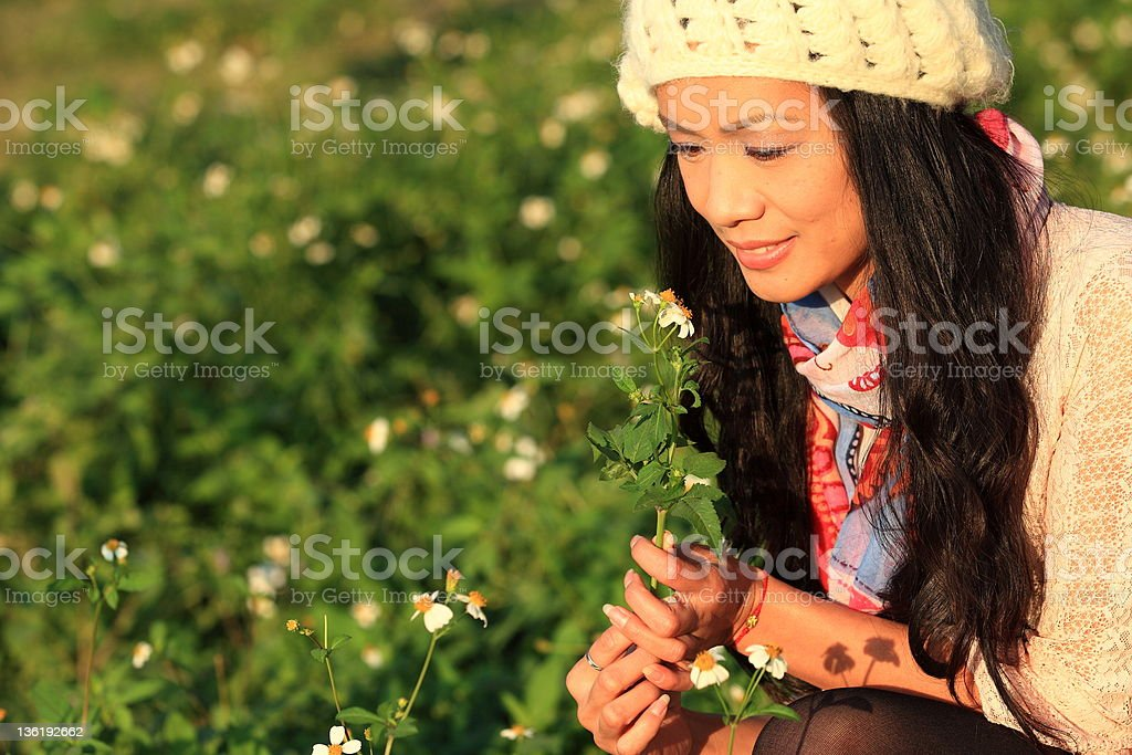 Pretty woman holing flower at outdoor royalty-free stock photo