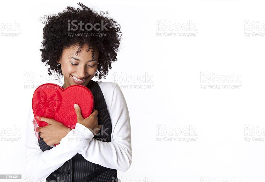 pretty woman hugging Valentine's Day heart box stock photo
