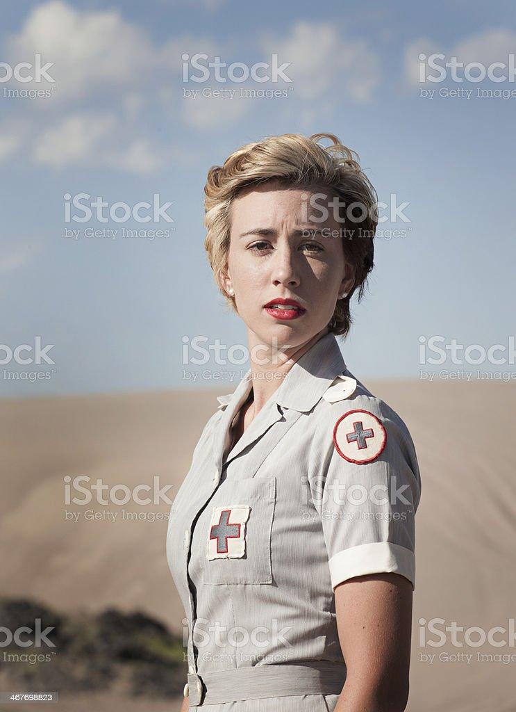Pretty Woman in a WWII Nurses Uniform royalty-free stock photo
