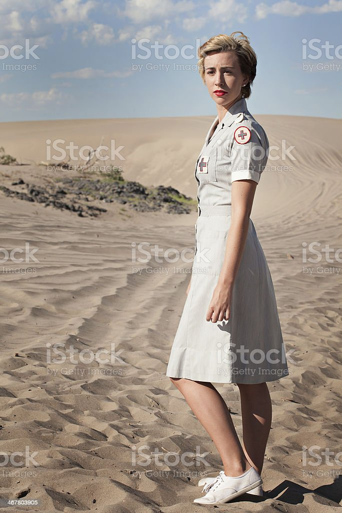 Pretty Woman in a WWII Nurses Uniform royalty-free stock photo
