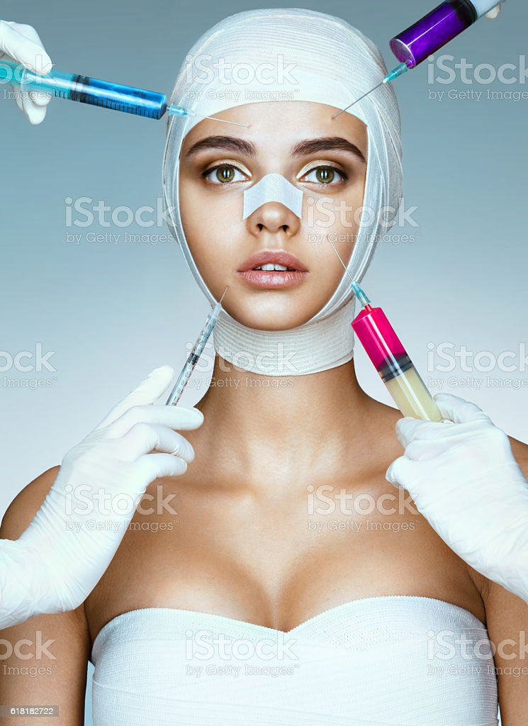 Pretty woman in medical bandages stock photo