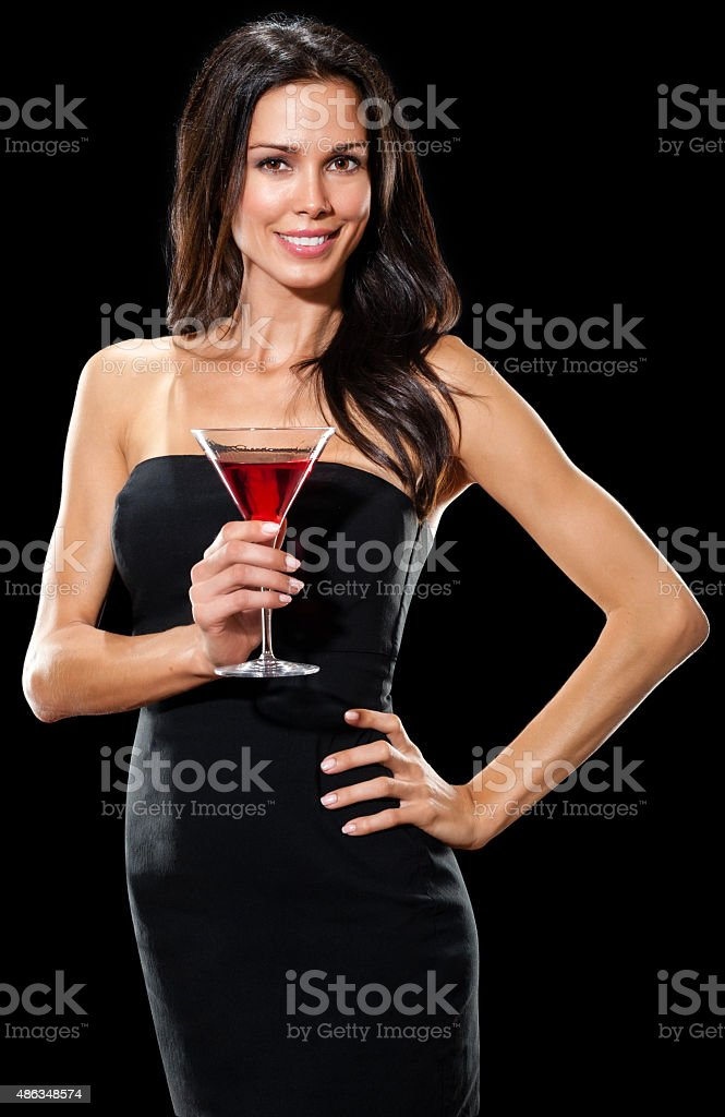 Pretty woman in party dress on black stock photo