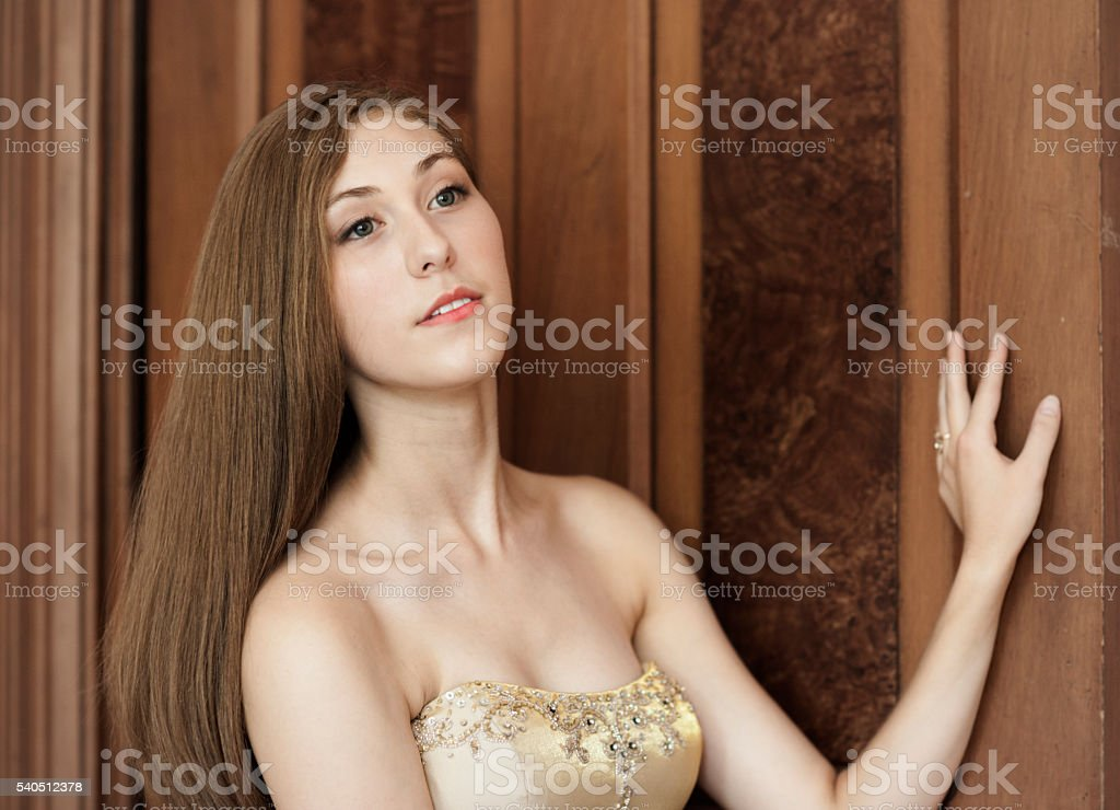 Pretty woman in strapless gown stock photo