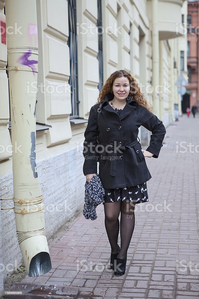 Pretty woman in the city streets royalty-free stock photo