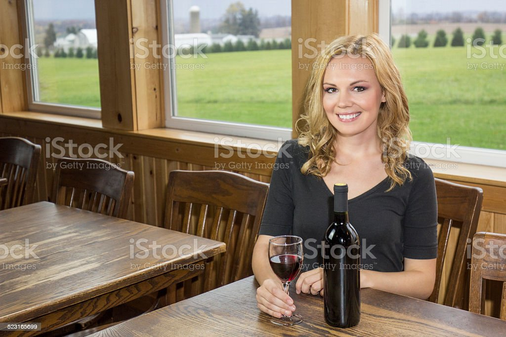 Pretty Woman in Winery or Bar with Red Wine stock photo