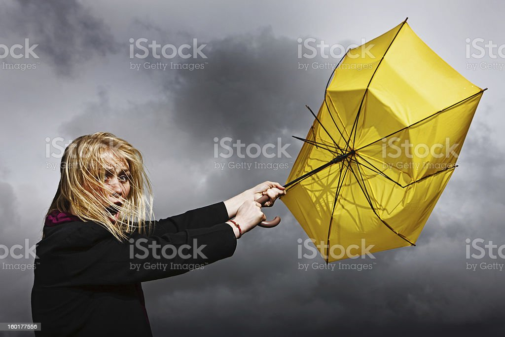 Pretty woman is blown away: not in a good way stock photo