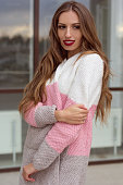 Pretty woman is wearing cozy knitted sweater