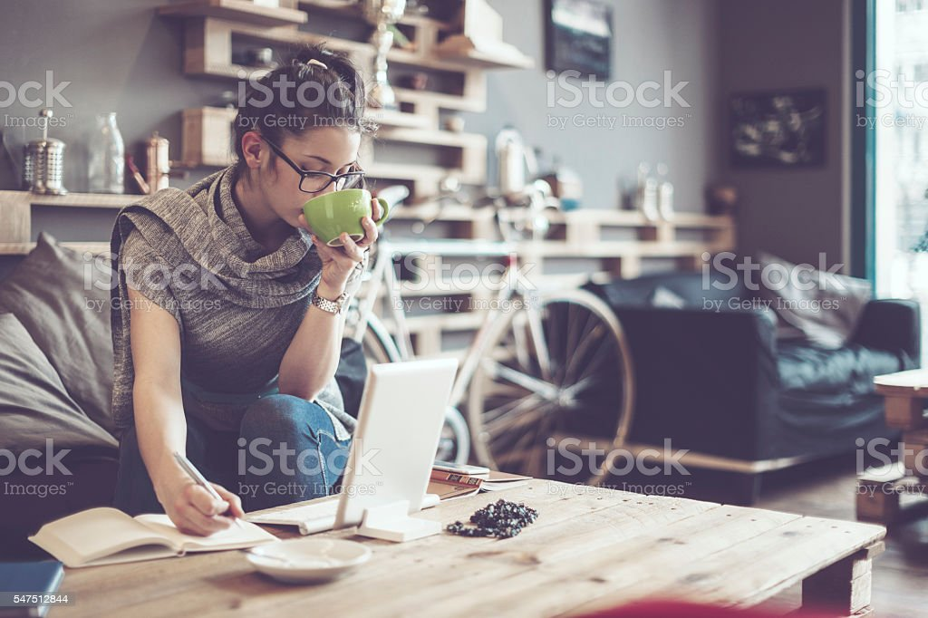 Pretty woman is working in a café stock photo