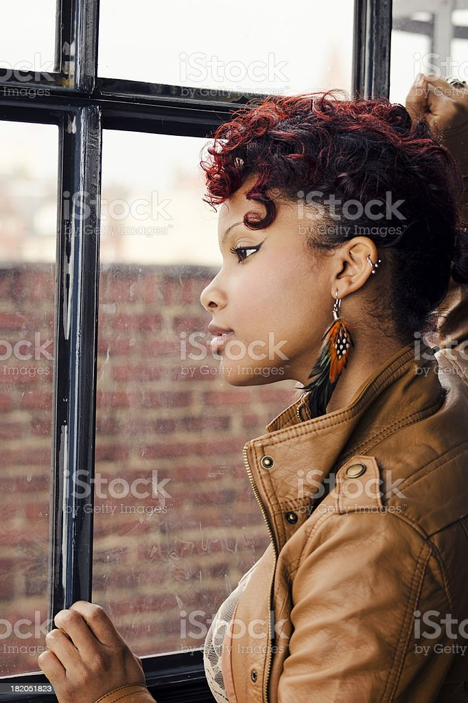 Pretty Woman Looking Out a Window stock photo