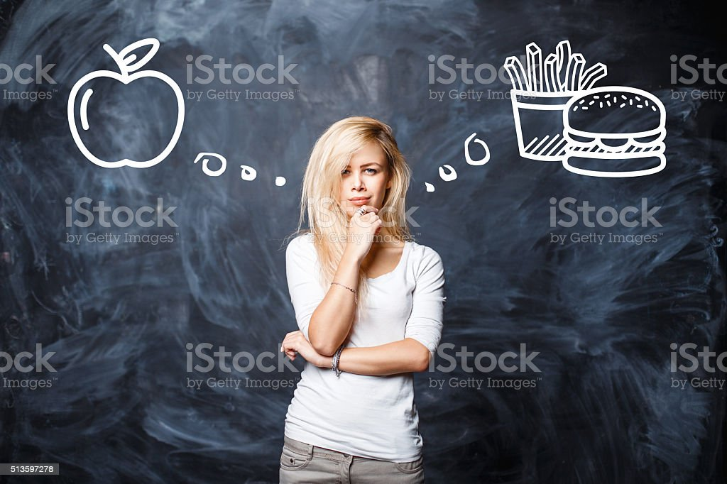 Pretty Woman makes a choice between bad food stock photo