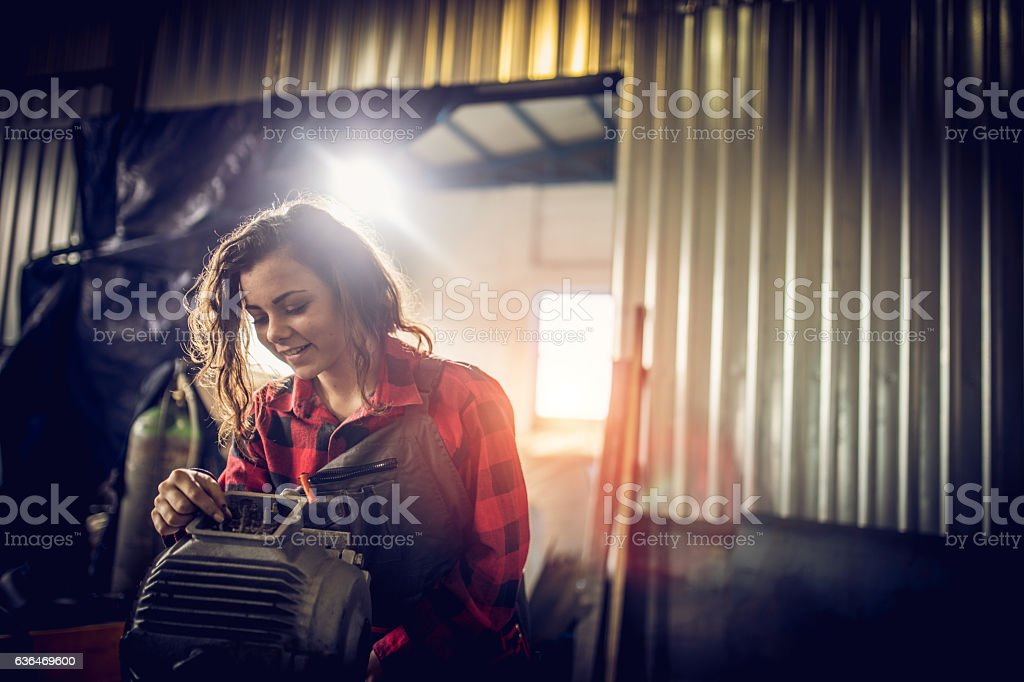 Pretty woman mechanic stock photo