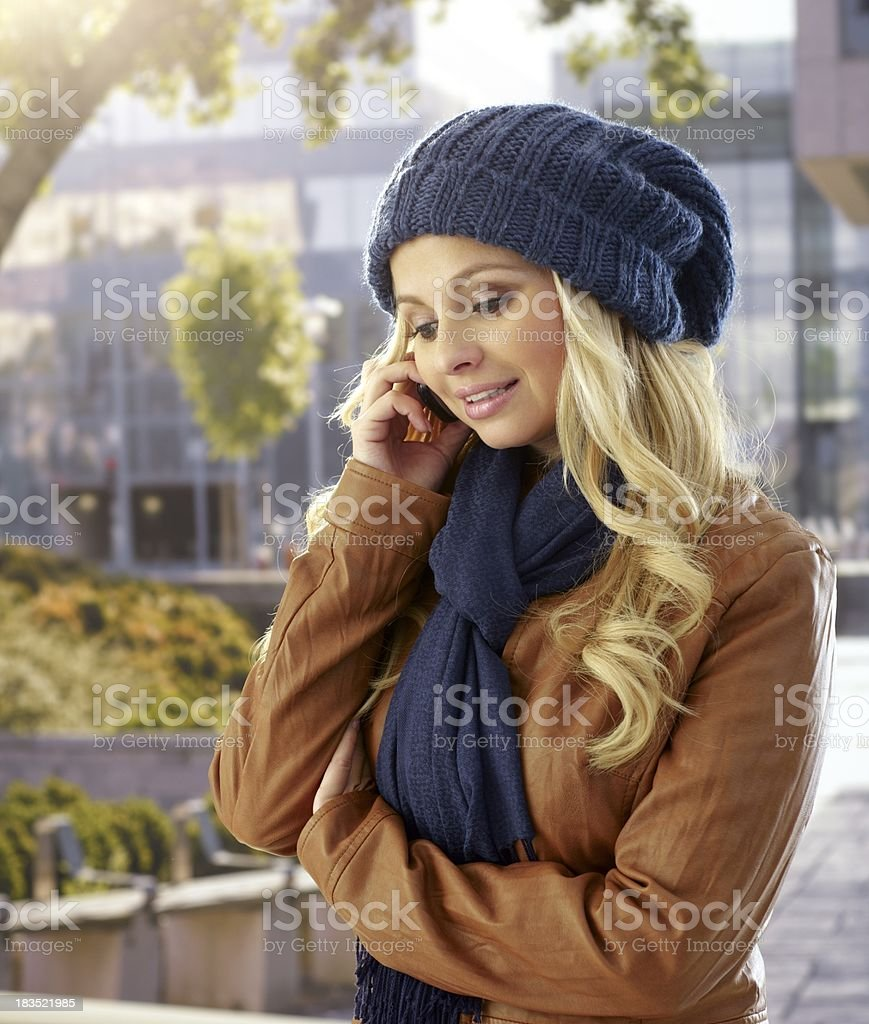 Pretty woman on mobile outdoors royalty-free stock photo