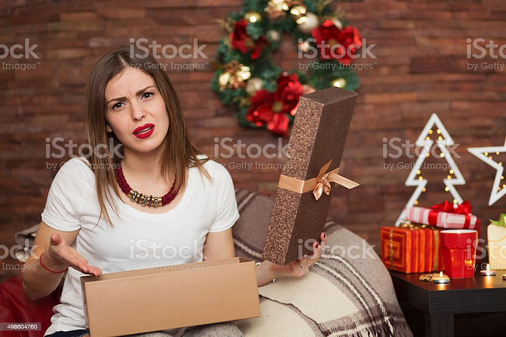 Pretty woman opening Christmas presents stock photo