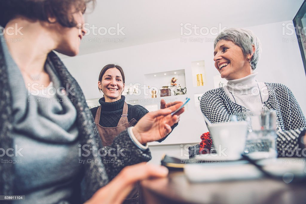 Pretty Woman Paying Bill for Coffee, Caffe Trieste, Europe stock photo