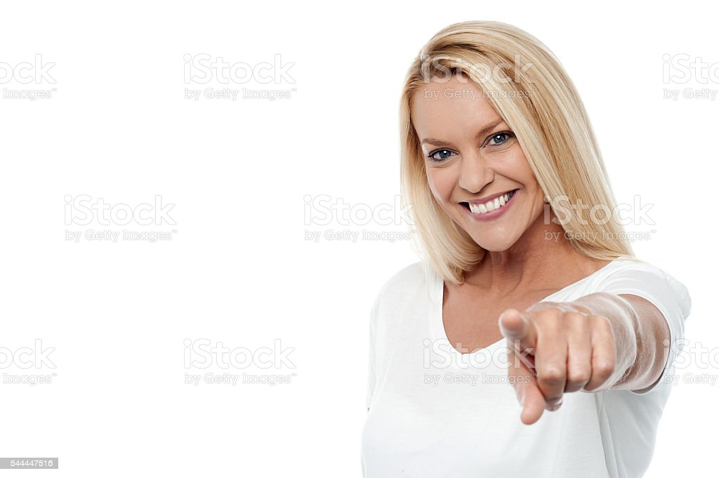 Pretty woman pointing you out stock photo