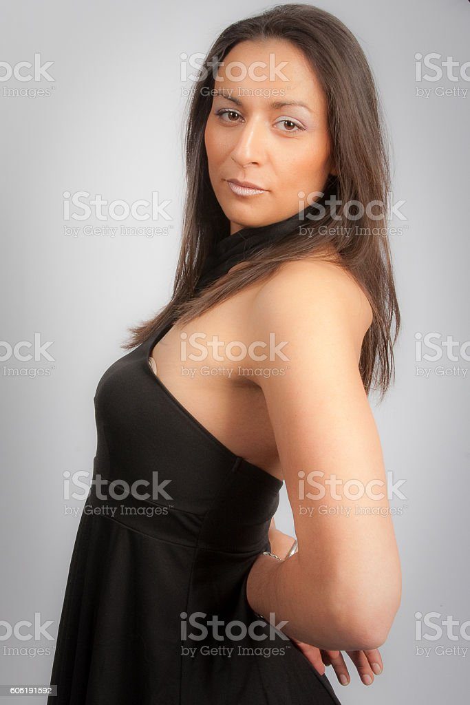 Pretty woman portrait isolated on grey background stock photo