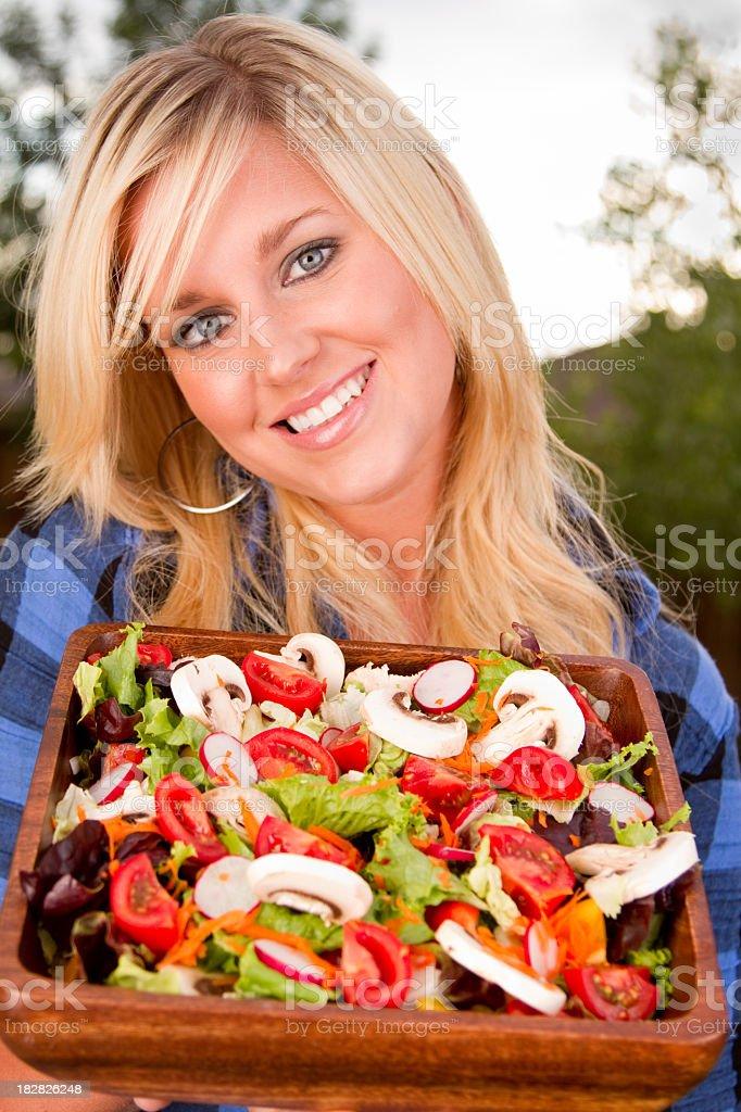 Pretty Woman Presenting Salad royalty-free stock photo