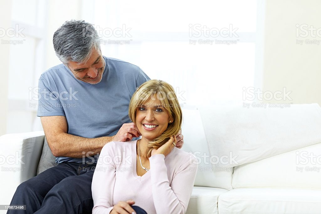 Pretty woman receiving necklace as gift from husband royalty-free stock photo