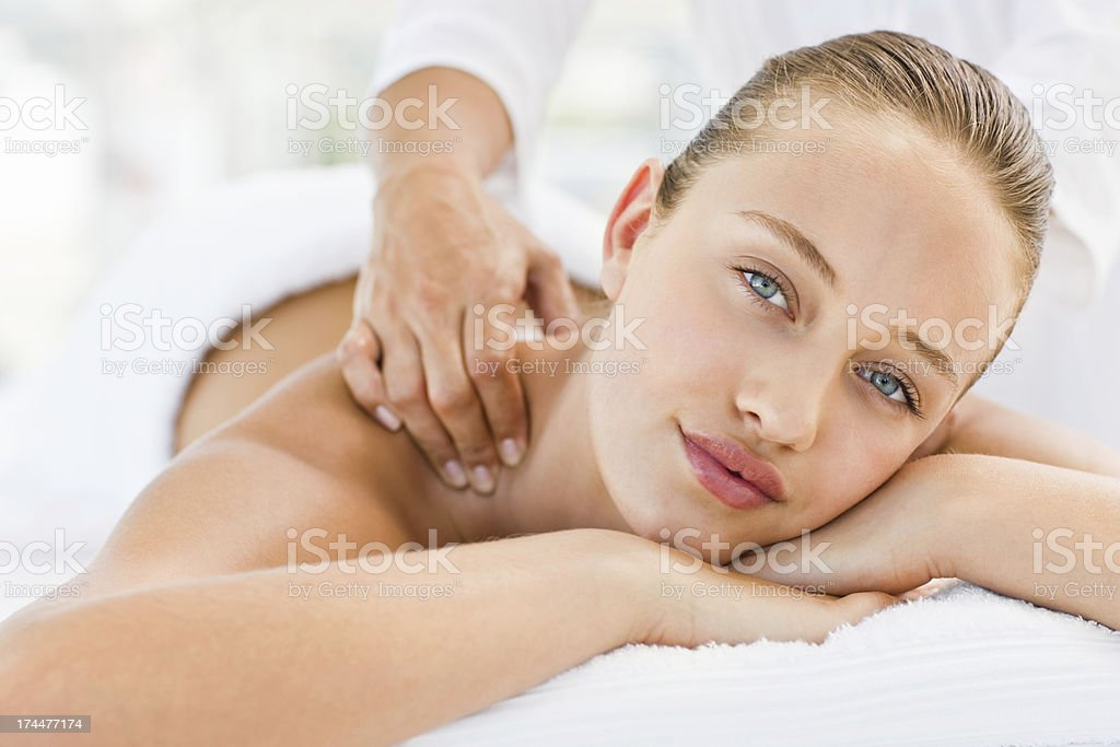 Pretty woman receiving shoulder massage at spa royalty-free stock photo