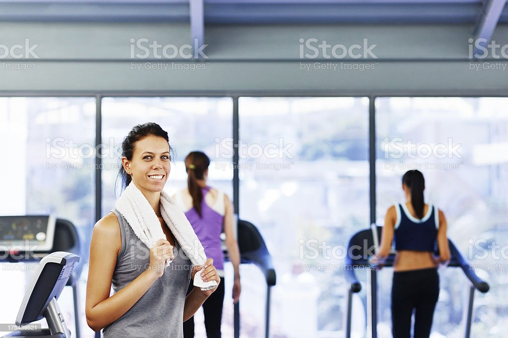 Pretty woman relaxing after exercise session in gym stock photo