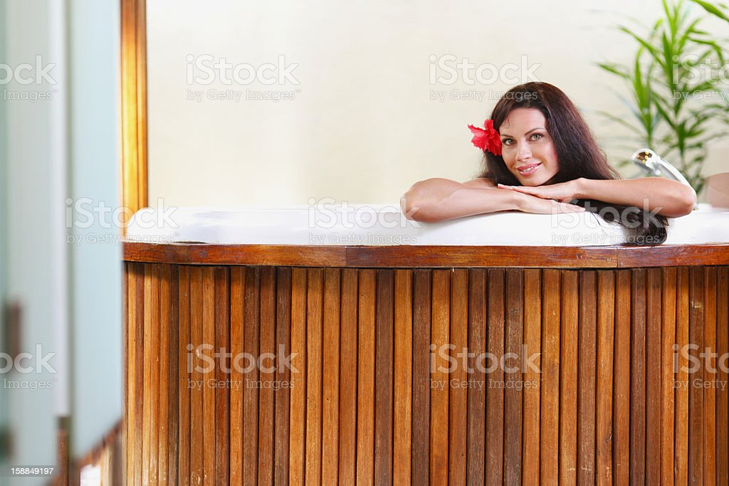 Pretty woman relaxing in jacuzzi royalty-free stock photo