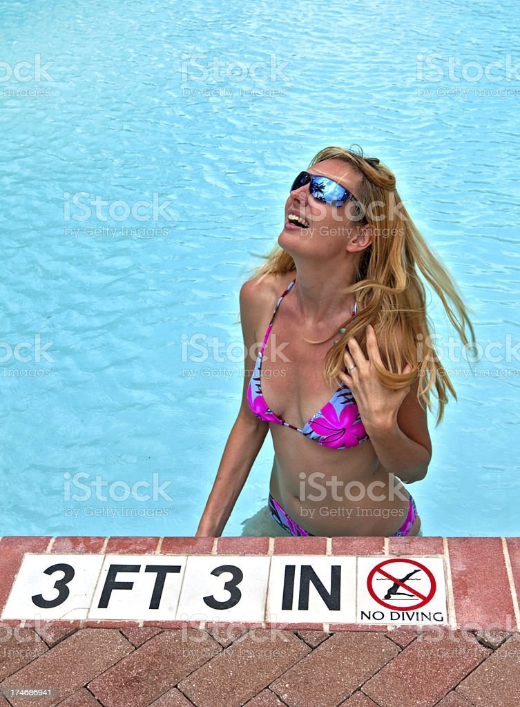 Pretty woman relaxing in the swimming pool,looking up stock photo