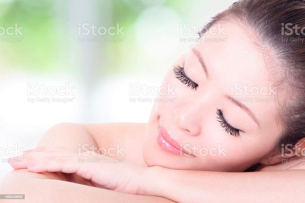Pretty woman relaxing with eyes closed royalty-free stock photo