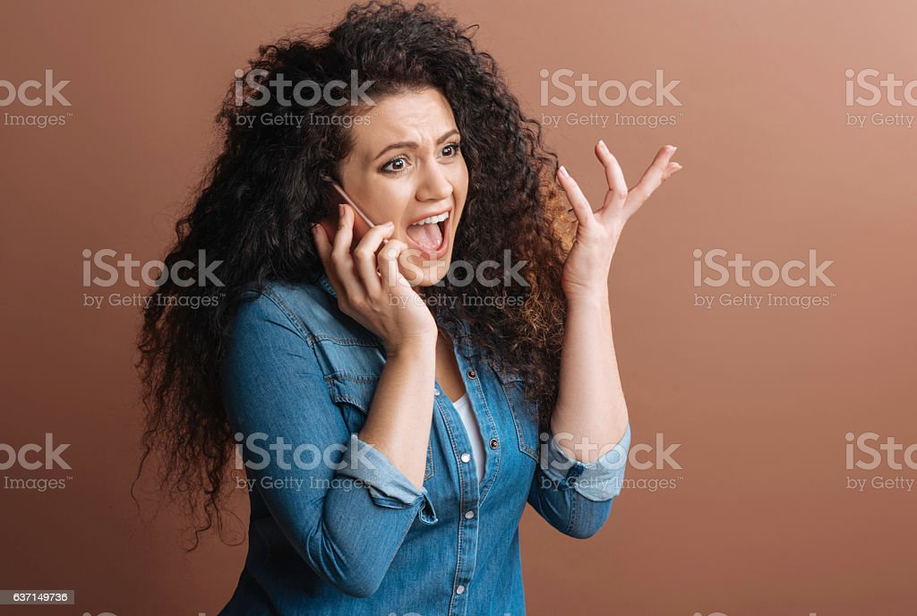 Pretty woman shouting at her conversationalist stock photo