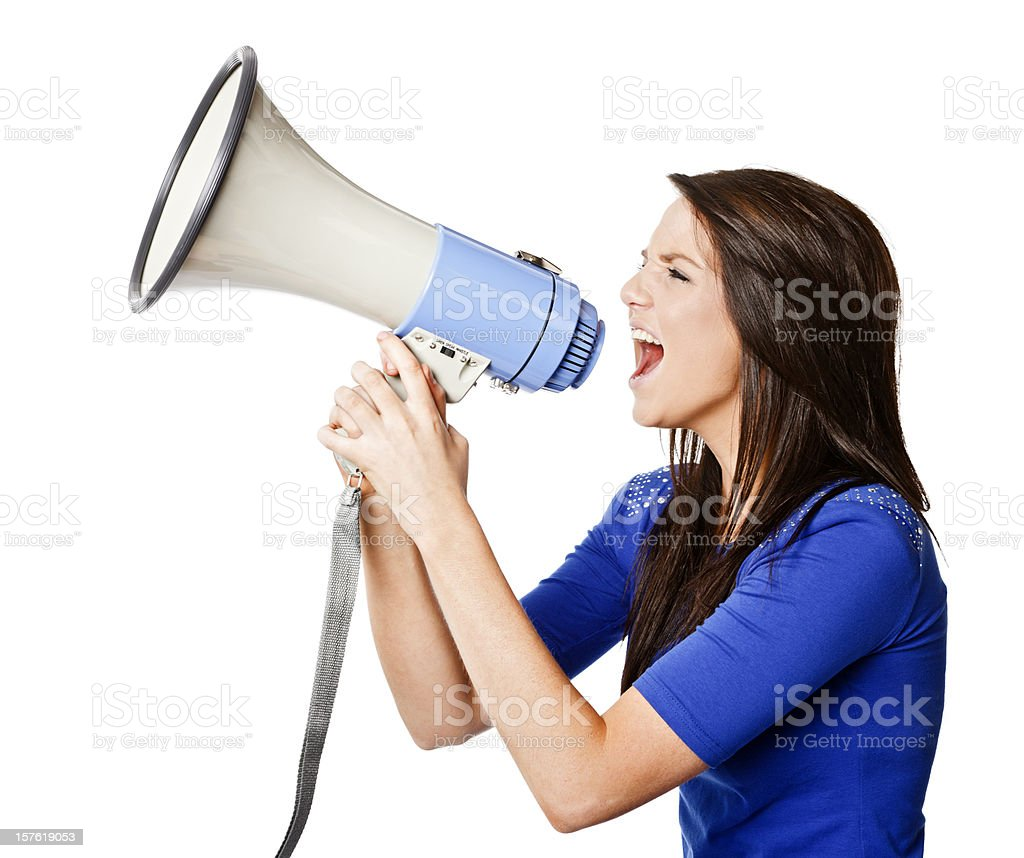 Pretty woman shouts into a megaphone, possibly protesting stock photo