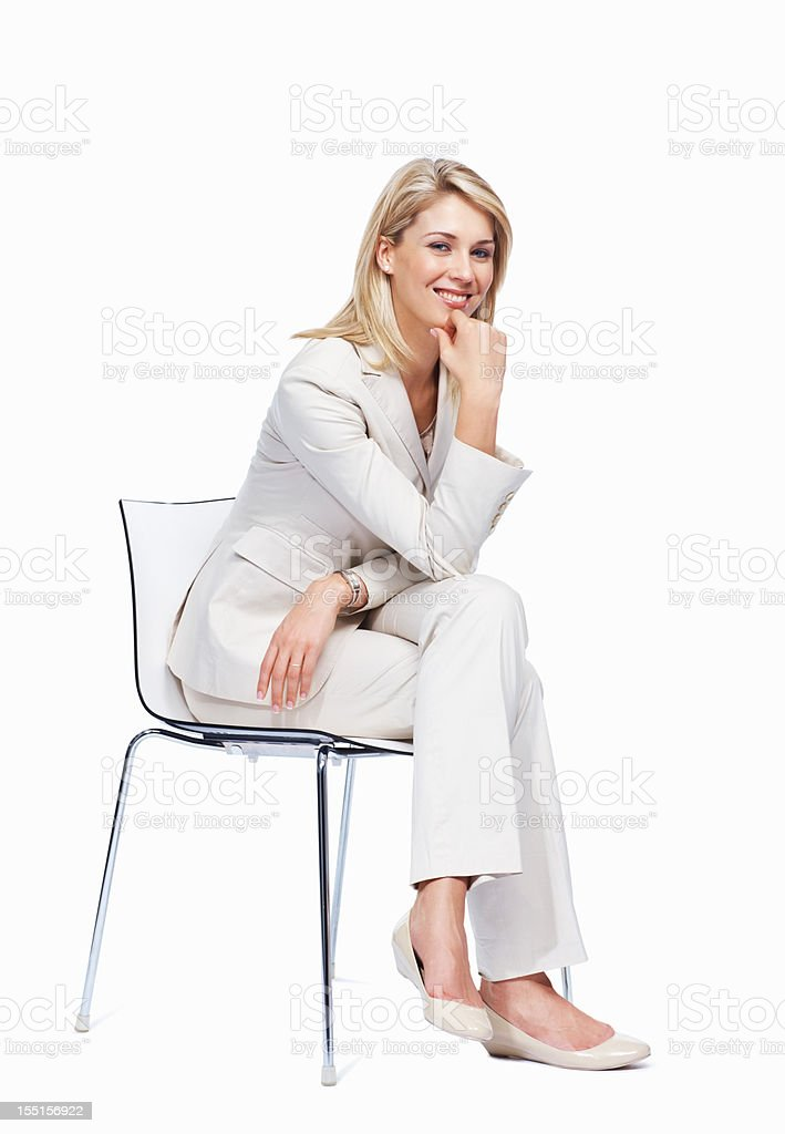 Pretty woman sitting on a chair royalty-free stock photo