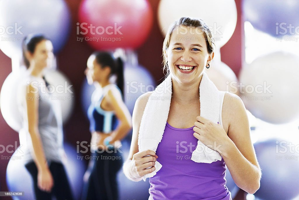 Pretty woman smiles after exercise stock photo