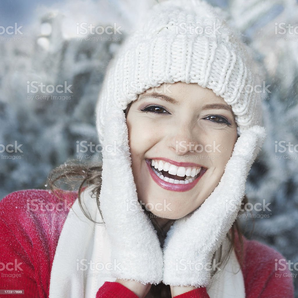 Pretty woman smiling as snowflakes fall on her face royalty-free stock photo
