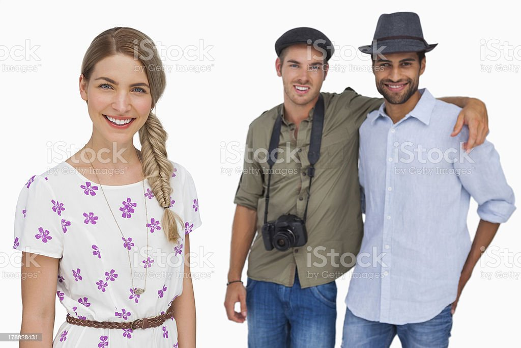 Pretty woman smiling with friends behind her royalty-free stock photo