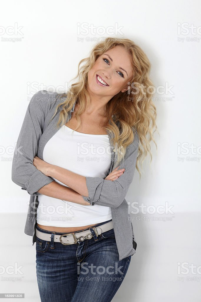 Pretty woman standing with arms crossed royalty-free stock photo