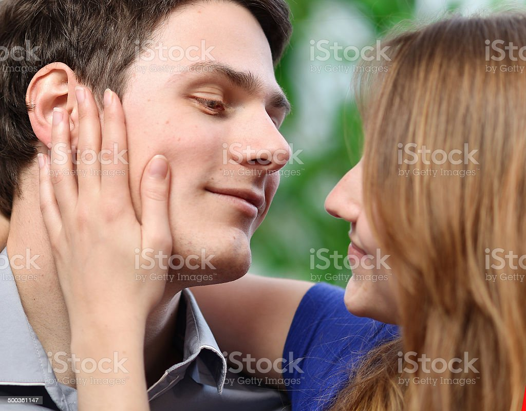 pretty woman stroking the cheek of her boyfriend with love royalty-free stock photo