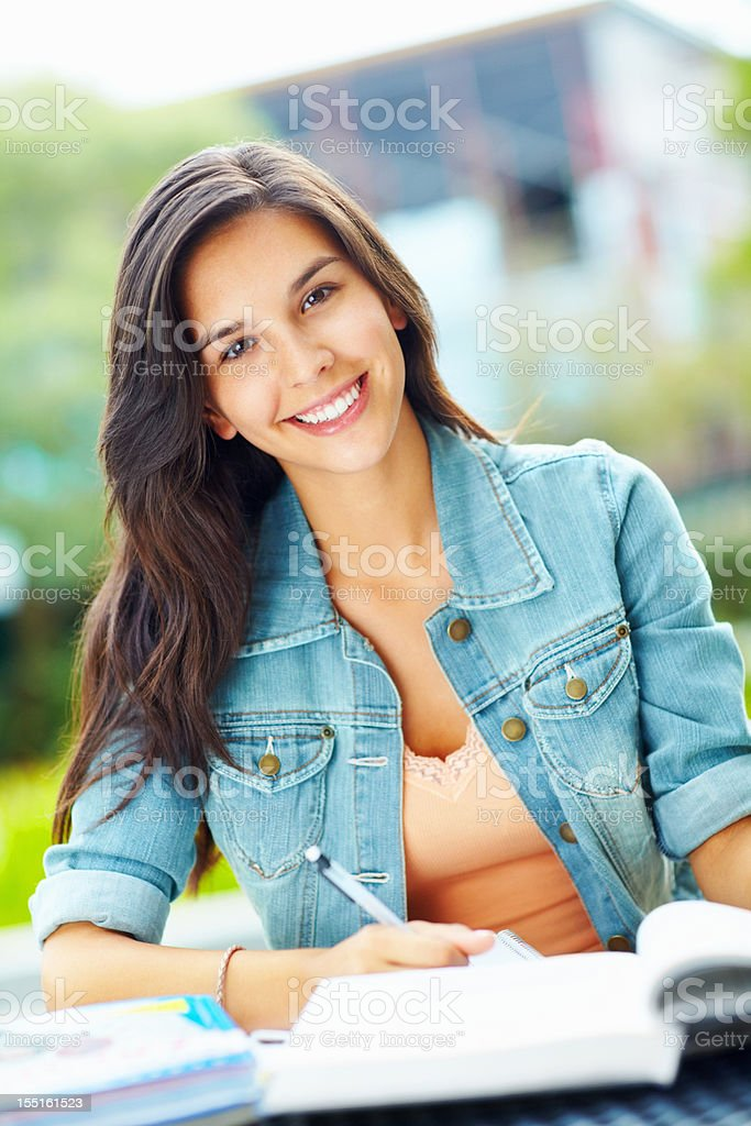 Pretty woman studying outdoors royalty-free stock photo