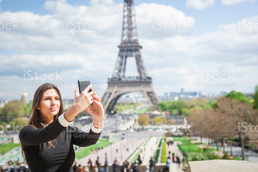 Pretty Woman Taking A Selfie Near The Eiffel Tower stock photo