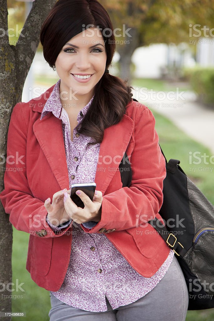 Pretty woman texting royalty-free stock photo
