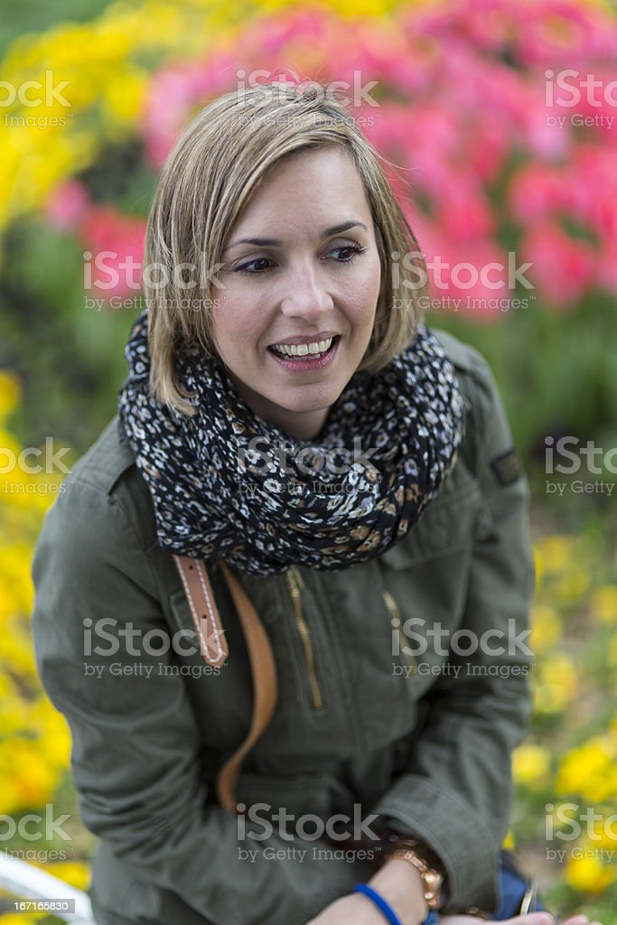 Pretty woman thinking what to do in a colorful park royalty-free stock photo
