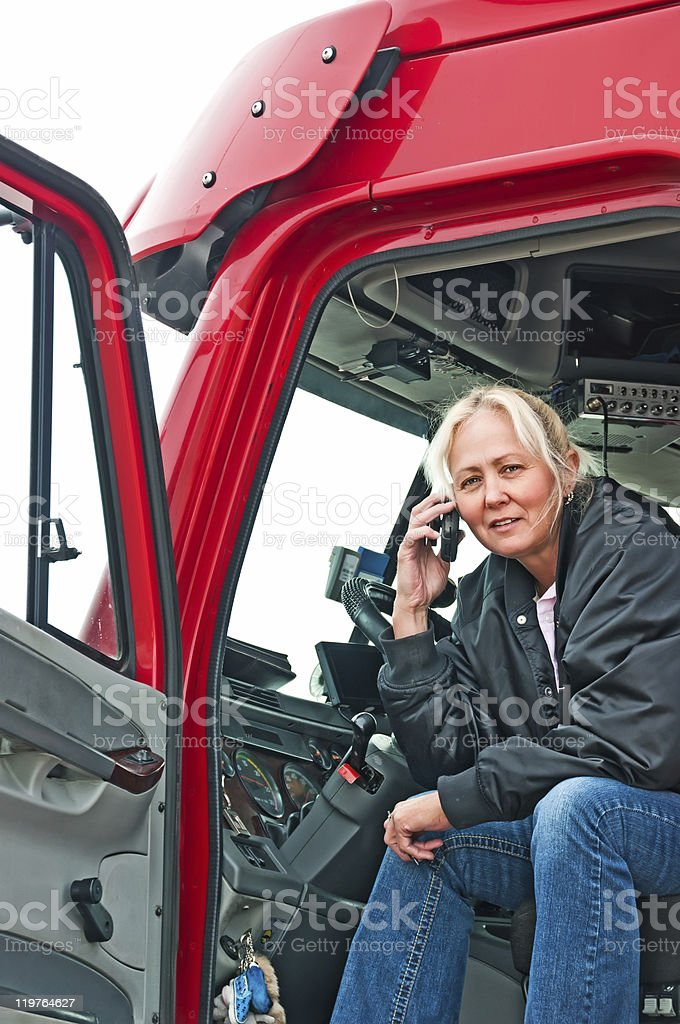 Pretty woman truck driver on phone stock photo