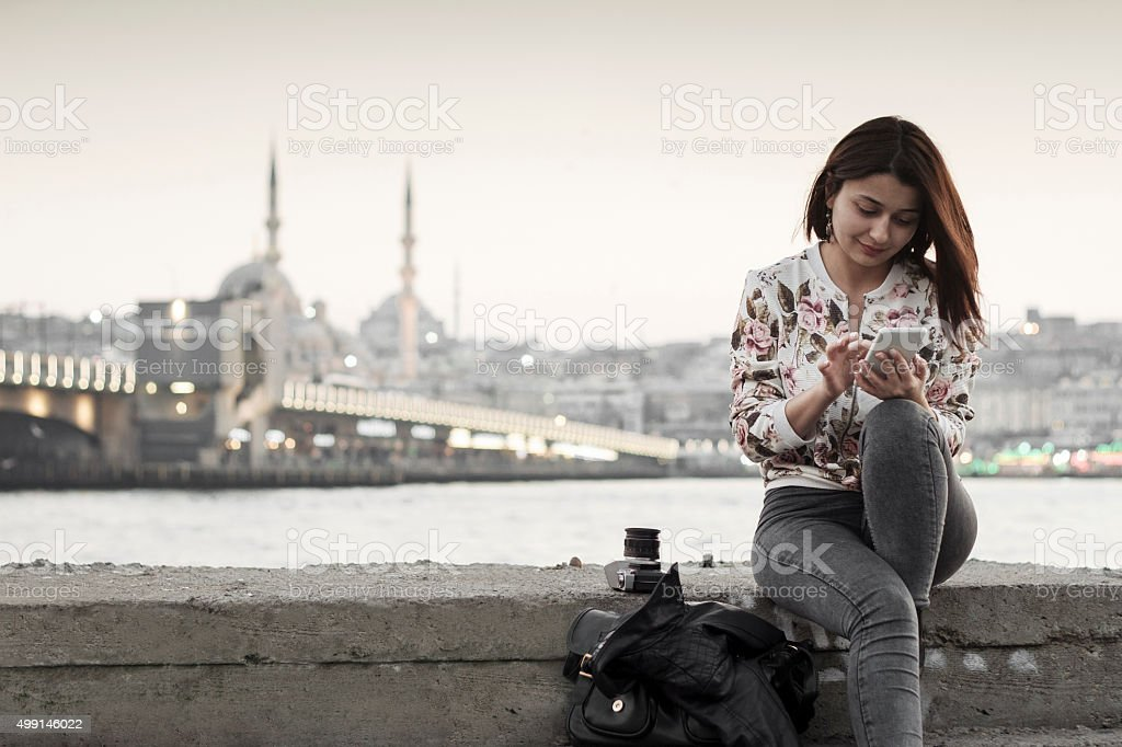 Pretty woman  using smart phone in Istanbul,Turkey stock photo