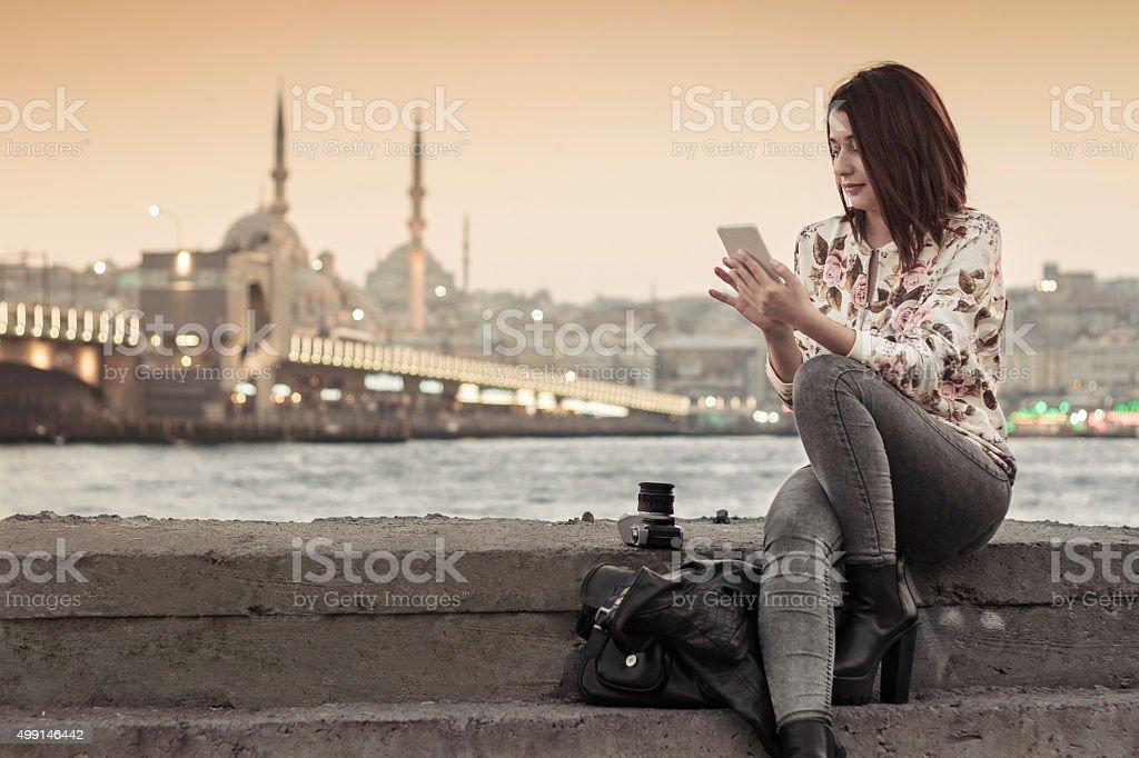 Pretty woman  using smart phone in Istanbul,Turkey stock photo