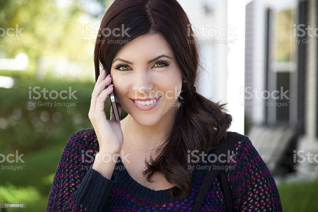 Pretty woman using smart phone royalty-free stock photo