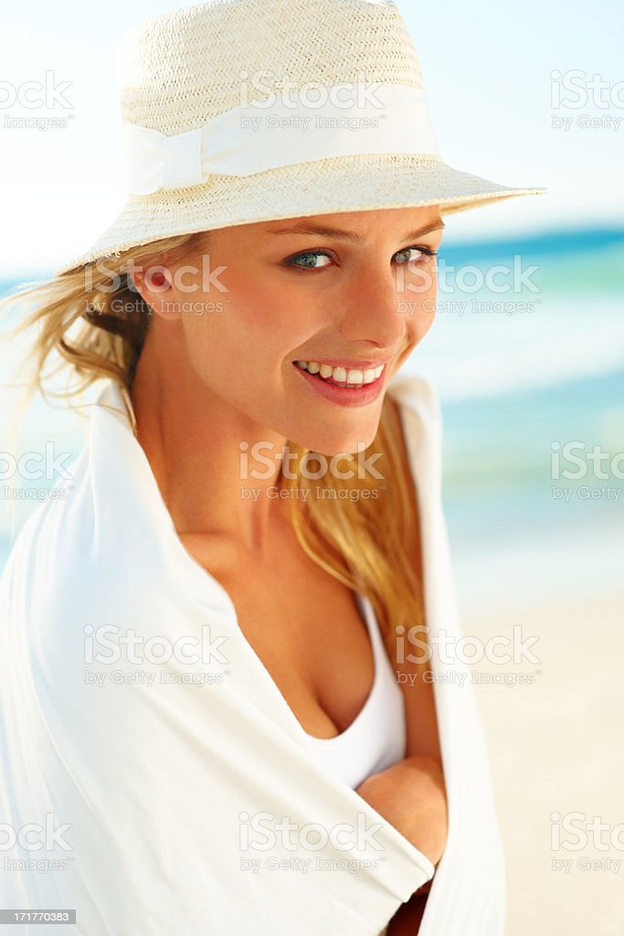Pretty woman wearing a shawl at the sea shore stock photo