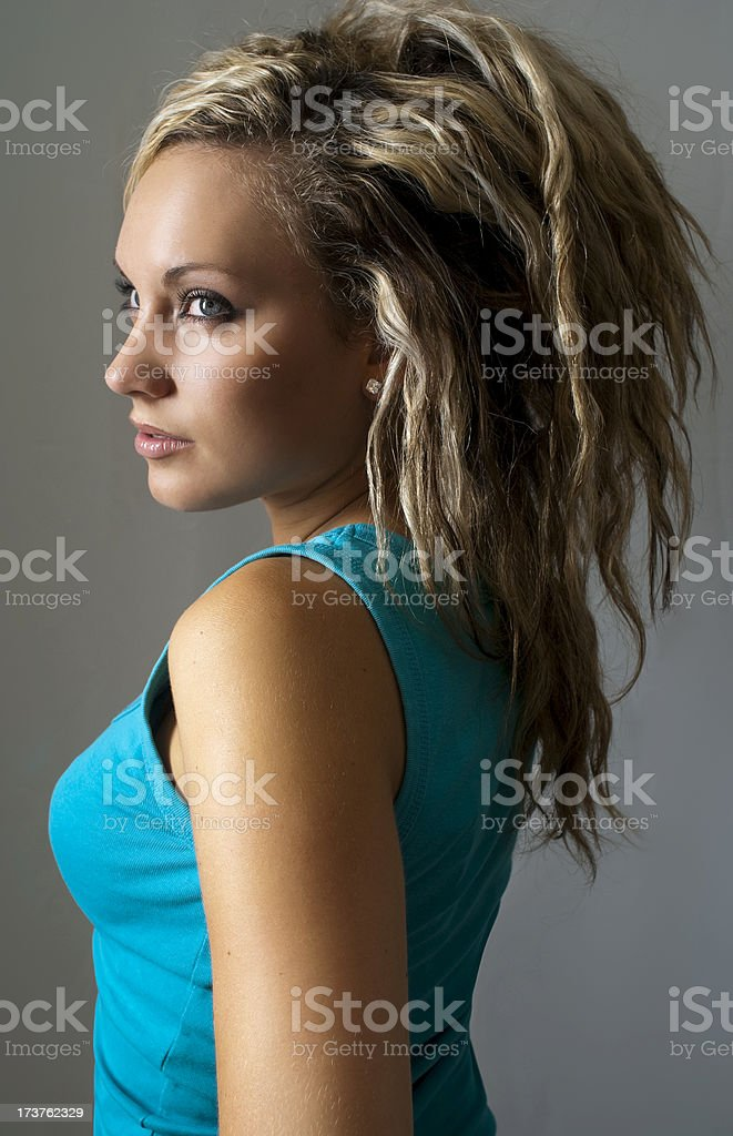 pretty woman wearing sleeveless blue top royalty-free stock photo